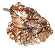 Один из символов богатства - трехлапая лягушка.